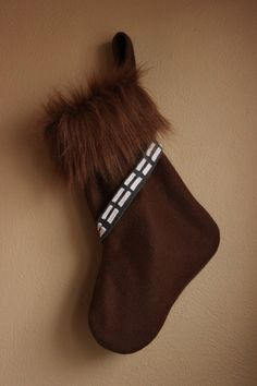 Wookie stocking. Would be cute to have each member of the family have a different character =).   My inner Star Wars geekness coming through!  Kayla you must see this!