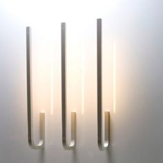 Angle Wall Light by Tom Dixon A collection of task lights powder coated in pantone Cool Grey Angle is made from extruded aluminium, one of the most Cool Lighting, Modern Lighting, Lighting Design, Candle Sconces, Wall Sconces, Wall Lamps, Tom Dixon, Luminaire Applique, Luminaire Design