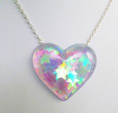 Holographic Iridescent Stars Heart Shaped Pendant by CandyShockUK Kawaii Jewelry, Cute Jewelry, Jewelry Accessories, Heart Jewelry, Space Grunge, Pastel Candy, Magical Jewelry, Resin Charms, Resin Jewelry