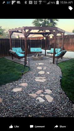 Fire pit and pallet swing gazebo with stone pathway.