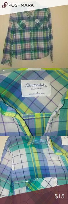 Aeropostale large juniors plaid long sleeve top It is a juniors size large by Aeropostale. It is collared. With two top button pockets on chest area. The wrist also buttons along with the button down front. It is a mixture of greens yellows blues purples and whites. RN#21726 Aeropostale  Tops Button Down Shirts