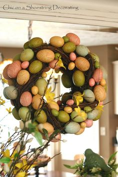 Easter egg wreath, at www.chiconashoestringdecorating.blogspot.com