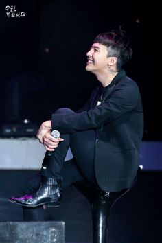 Let's be honest He's probably looking at Seungri.