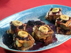 "Peanut Butter French Toast ""Waffles"" with Mixed Berry Sauce recipe from Bobby Flay via Food Network"