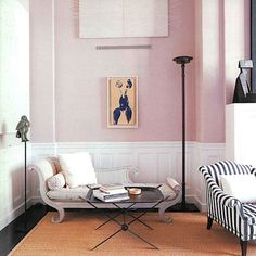 <parisian home style> living room with pretty striped chaise chairs + soft pink walls
