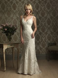 Style: 8856  This slim and sexy silhouette is created from an all-over lace applique. This gown is a two-piece dress with a charmeuse slip beneath the lace overlay. The v-neckline and v-shaped back.