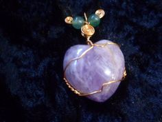 This is a Amethyst Heart Wrap done with Bronze wire and Aventurine beads.The Necklace is about 2 inches from the base of the heart to the top of the cord loop. Comes with cord and mesh bag to protect the necklace, to be worn as a necklace.