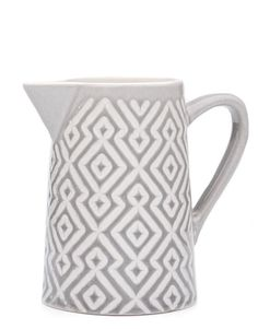 Stamped in a cultured-cool pattern, this small pitcher gives us cravings for iced mint tea and a cool summer spread (think a bunch of plates and an even better bunch of friends). - Ceramic - tall x diameter at base - Dishwasher & microwave safe