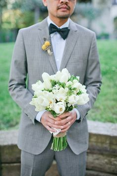 Crisp white tulips + greenery = bouquet perfection.