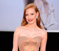 Best Actress nominee Jessica Chastain in Harry Winston vintage 1969 earrings set with diamonds totalling 10ct and Harry Winston vintage 1967 diamond and gold bracelet, set with 24ct of diamonds.