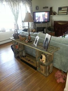 Wooden Crates Ideas | Sofa table made from shutter and old wood milk crates.