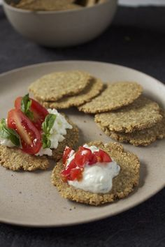 Flax Seed and Almond Crackers Full of Omega 3 and Low Carb ~ these sound tasty!   1/2 cup Ground Flax Seed  1/2 cup old fashioned rolled oats or quinoa flakes  1/2 cup almonds (or nut of choice)  1/2 cup sesame seeds (or seed of choice)  1/2 tsp salt and plenty of fresh ground pepper  1 tsp each dried thyme and rosemary  1 egg  2 Tbsp olive oil  2-3 Tbsp water