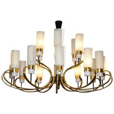 Large Italian 50's brass chandelier | From a unique collection of antique and modern chandeliers and pendants  at http://www.1stdibs.com/furniture/lighting/chandeliers-pendant-lights/