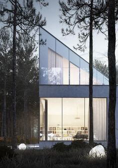 Casa con grandes ventanales y techo inclinado