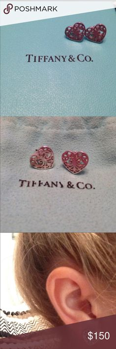"Tiffany & Co. Enchant Collection Heart Earrings ""The scrolled iron gates of opulent estates and secret gardens inspired this ornate collection. Fanciful curves create this dynamic yet dainty heart earrings."" Sterling Silver. Ships with original Tiffany & Co. jewelry bag and box. In excellent condition! Check out the matching Enchant Collection Tiffany & Co. ring posted. I offer bundle discount! Tiffany & Co. Jewelry Earrings"