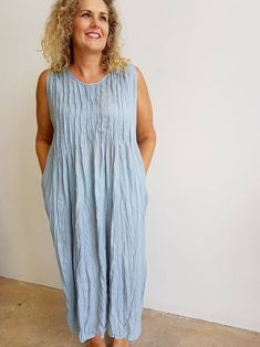 Long, sleeveless Summer dress with pintuck detail on bust. Made of crinkle textured cotton with pockets. Plus Size. Silver Grey.