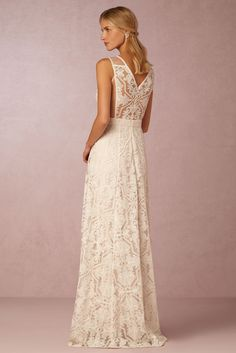 Simple bohemian wedding dress with unexpectedly-detailed lace back. Sheer tulle panels at the sides of the bodice give way to a v-shaped panel of the same graphic lace seen throughout the gown, only unlined, creating a beautiful, modern statement. A full A-line skirt completes the look.   Pendleton Gown by Tadashi Shoji for BHLDN
