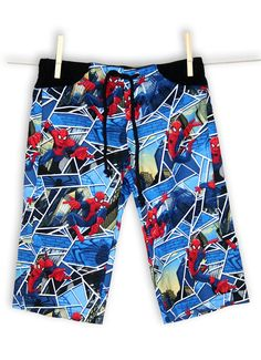 NIKI Spiderman Pocket Bermudas. Amazing Spiderman print for all superheroes' fans! Join the adventure!  Our unisex cotton summer trousers in 3/4 length are super comfortable and practical. Kids enjoy especially the big pockets for storing their treasures.  Elastic waistband for a great fit. Ideal to be active and play and feel free. Unisex.