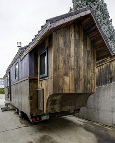 A Pella wooden sliding glass door, dark bronze clad windows, Onduvilla roof, and steel trim complete the exterior. Tiny House Cabin, Tiny House Design, Tiny House On Wheels, Tiny House Movement, Bungalows, Maple Wood Flooring, Tiny Mobile House, Mobile Homes, Tiny House Listings