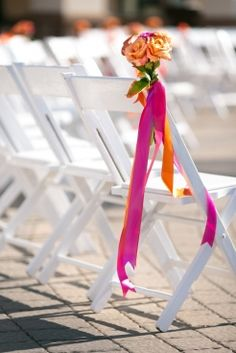 Pink and Orange Wedding, aisle decorations, wedding aisle, chair adornment, Photographed by Erich Camping, floral design by Stacy K Floral