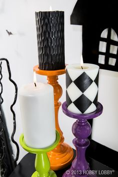 Paint basic candlesticks in Halloween hues to give your display a pop of spooky color.
