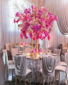 Overflowing pink florals and mixed silver & gold tabletop details took our breath away. (Venue: @redbird | @vibianaevents / Food & Beverage: @nealfraser @tobinshea / Planning and Design: @AllureEventsAtelier / Flowers and Design: @CeliosDesign / Photography: @KatieBeverleyPhoto / Chairs: @ClassicParty / Napkins: @luxe_linen / Linen: @latavolalinen / Drapery and Furniture: @RevelryEventDesign / Cake @rafispastry / Tabletop Rentals: @fancy_tables)