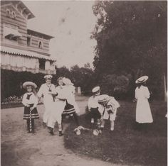 themauveroom:  Grand Duchesses Anastasia and Tatiana playing with their brother and their Aunt Xenia's children: 1908.