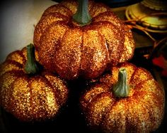 I love these GLITTER pumpkins!.  They were originally a martha stewart idea that I explored with and created something fabulous.  I use fake pumpkins so they dont die each year and dont rot in the heat!    Splurge on the martha stewart glitter it's worth it!!    happy fall ya'all :)