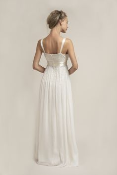 PP6253 l Ombre style hand beading cascades down the neckline and delicately through the waistline to give this dress a magical effect. An attached pleated cream silk waistband adds shape to the waist flattering the bride. #sajawedding