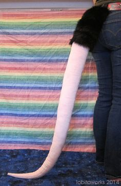 This is a custom listing for a rat/mouse/opossum tail, a little over 4 feet in length. You choose what colors you want on your tail, and itll be constructed with the same pattern as the example photo. These are made from fake fur and stuffed with lightweight polyfil stuffing. They are sewn by hand very sturdily, with two nylon beltloops to keep it securely on your belt. Completion time depends on our current workload. Expect 2-4 weeks for completion. Want a differently-shaped tail or…