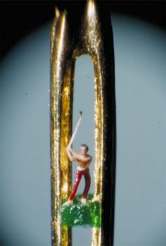 more microscopic sculpture, a golfer in the eye of a needle