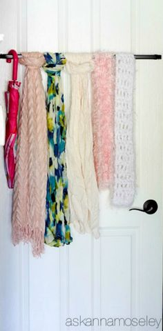 If rings aren't your thing, store scarves on your closet door by looping them over a small curtain rod. To avoid damage to the door, apply two adhesive Command hooks and place each end of the rod in the hook. Get the tutorial here.     - Redbook.com