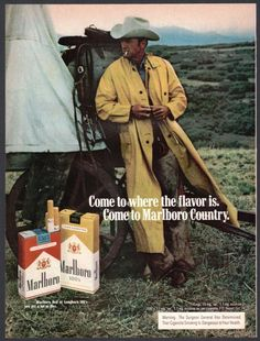 1974 MARLBORO MAN CIGARETTES AD Cowboy in Long Rain Slicker