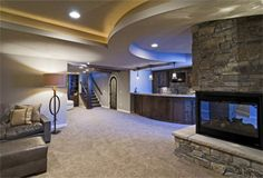 "Think outside the box. Use curves and  warm colors to create a ""great room"" in your basement #DIY #roominspiration. Get more inspiration: http://www.familyhandyman.com/basement/basement-finishing-tips/view-all"