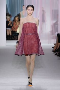 Dior Spring Summer 2013 Ready-to-Wear – Look 37: Fuchsia and orange double layered knitted bustier dress. Discover more on www.dior.com #Dior#PFW