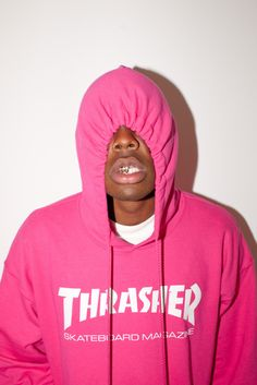 Tyler the Creator in a pink Thrasher hoodie.