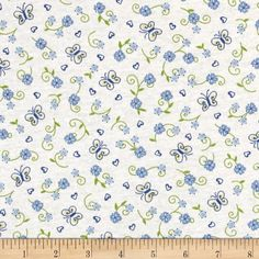 Children+Cotton+Knit+Flowers+Blue/White from @fabricdotcom  This+cotton+jersey+knit+fabric+has+a+soft+hand+and+about+15%+stretch+across+the+grain.+This+versatile+fabric+is+perfect+for+creating+kids'+apparel+and+T-shirts.