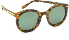 KAREN WALKER SUPER DUPER STRENGTH SUNGLASSES  $280 by Karen Walker at shopbop.com          Available Colors: Crazy Tort Available Sizes: One Size DETAILS These oversized, rounded sunglasses feature a tortoiseshell plastic frame. Metal arrow at temples. Case and cleaning cloth included. Oversized frame. Non-polarized lenses. Imported, China. Measurements Width: 5.75in / 14.5cm Height: 2.5in / 6.5cm Lens Width: 55mm