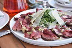 Check out this delicious recipe for Barbecued Beef Carpaccio from Weber—the world's number one authority in grilling. Carpaccio Recipe, Beef Fillet, Weber Bbq, Pickle Relish, Arugula, Christmas Recipes, Meat Recipes, Barbecue, Yummy Food