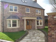Stunning A-rated energy efficient double glazing, coloured and aluminium windows installed by Kingfisher Windows of Leeds. Talk to us today. Upvc Sash Windows, Front Doors With Windows, Timber Windows, Aluminium Windows, Wooden Windows, Large Windows, Bay Windows, Bay Window Exterior, House With Porch