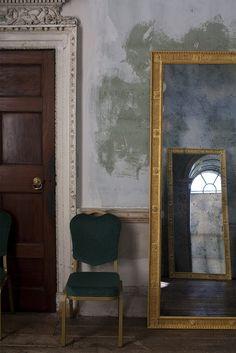 Crown molding, antique door & mirror, wall coloring