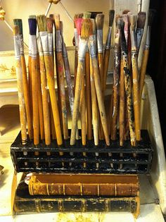 Paint brushes in wonderful vintage holder