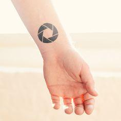 Fake aperture tattoo by Tattly
