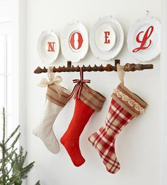 Easy Fabric Stockings from big, I love the plates and the rustic rail they are hanging from.