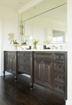 Master bathroom vanity as furniture inspiration, custom with open towel storage and one large sink with two faucets in the center