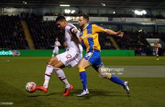 Chris Smalling of Manchester United and Andy Mangan of Shrewsbury Town during the Emirates FA Cup match between Shrewsbury Town and Manchester United at New Meadow on February 22, 2016 in Shrewsbury, England.
