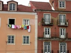 A colorful clothesline on a cloudy day in Lisbon