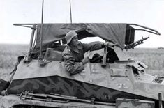 A soldier in a SdKfz 250/3 on the battlefield