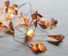 DIY Christmas lights: Cut pieces of newspapers and tape them onto a set of chasing lights.