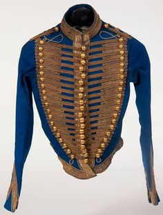 """IMPERIAL RUSSIAN CRIMEAN WAR HUSSAR'S MILITARY JACKET, CIRCA 1855.  Bright blue wool Attila for an officer of the 12th Regiment with gold bullion cord frogging and collar and cuff braid.  Triple row of brass ball buttons with the unit number """"12"""".  Lined in padded white silk, now considerably frayed."""